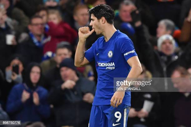 Chelsea's Spanish striker Alvaro Morata celebrates scoring the opening goal of the English Premier League football match between Chelsea and Brighton...