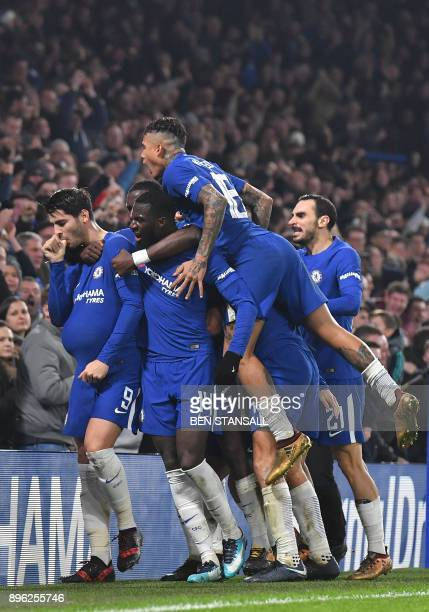 Chelsea's Spanish striker Alvaro Morata celebrates scoring the team's second goal with teammates during the English League Cup quarterfinal football...