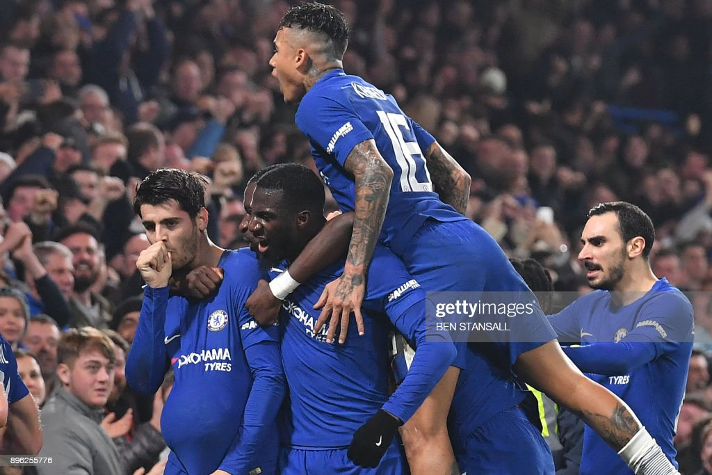 TOPSHOT - Chelsea's Spanish striker Alvaro Morata (L) celebrates scoring the team's second goal, with teammates during the English League Cup quarter-final football match between Chelsea and Bournemouth at Stamford Bridge Stadium, in southwest London on December 20, 2017. / AFP PHOTO / Ben STANSALL / RESTRICTED TO EDITORIAL USE. No use with unauthorized audio, video, data, fixture lists, club/league logos or 'live' services. Online in-match use limited to 75 images, no video emulation. No use in betting, games or single club/league/player publications. /