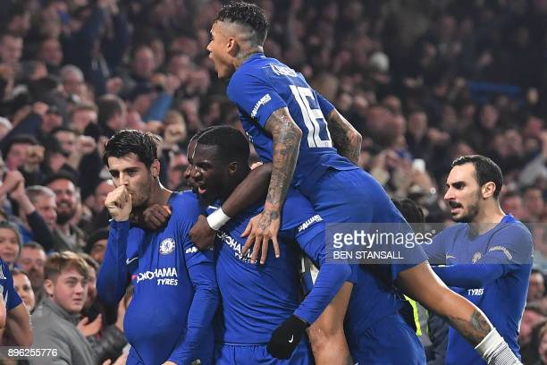 TOPSHOT Chelsea's Spanish striker Alvaro Morata celebrates scoring the team's second goal with teammates during the English League Cup quarterfinal...