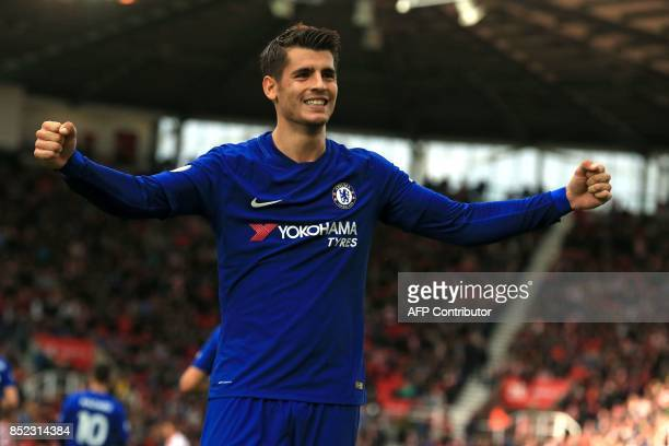 Chelsea's Spanish striker Alvaro Morata celebrates scoring their third goal during the English Premier League football match between Stoke City and...