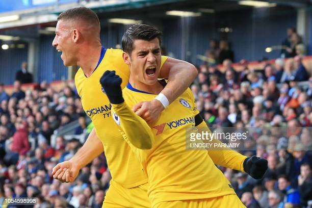 Chelsea's Spanish striker Alvaro Morata celebrates with Chelsea's English midfielder Ross Barkley after scoring the opening goal of the English...