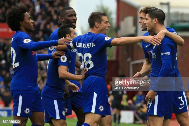 Chelsea's Spanish striker Alvaro Morata celebrates with teammates after scoring the opening goal of the English Premier League football match between...