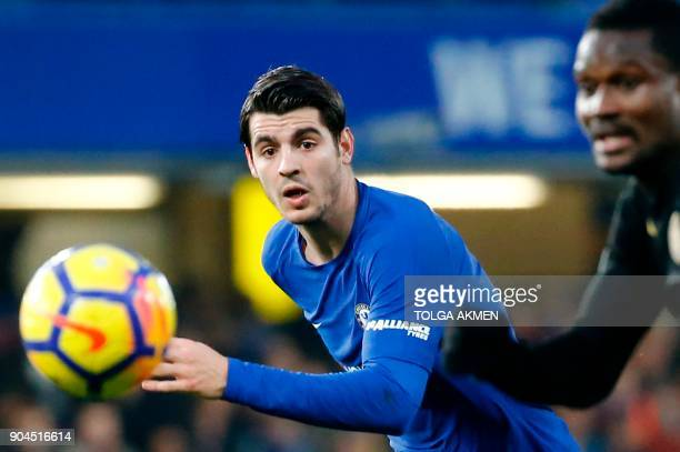 Chelsea's Spanish striker Alvaro Morata eyes the ball during the English Premier League football match between Chelsea and Leicester City at Stamford...