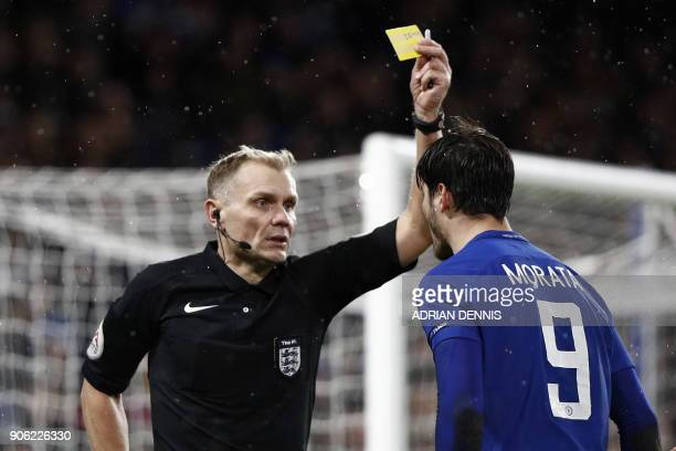 Chelsea's Spanish striker Alvaro Morata gestures to referee Graham Scott as he gets a yellow card during the FA Cup third round replay football match...