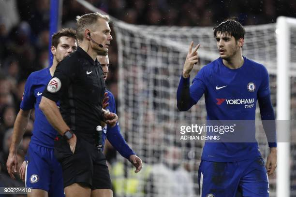 Chelsea's Spanish striker Alvaro Morata gestures to referee Graham Scott during the FA Cup third round replay football match between Chelsea and...