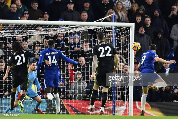 Chelsea's Spanish striker Alvaro Morata heads past Brighton's Australian goalkeeper Mathew Ryan to score the opening goal of the English Premier...