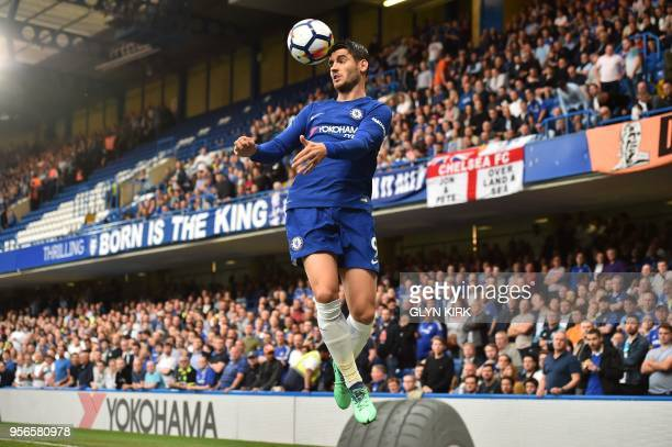 Chelsea's Spanish striker Alvaro Morata heads the ball during the English Premier League football match between Chelsea and Huddersfield Town at...