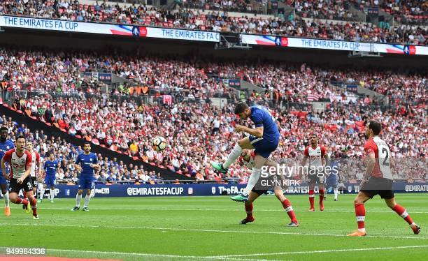 Chelsea's Spanish striker Alvaro Morata heads the ball to score his team's second goal uring the English FA Cup semifinal football match between...