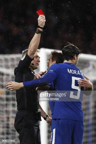Chelsea's Spanish striker Alvaro Morata receives a red card from referee Graham Scott during the FA Cup third round replay football match between...