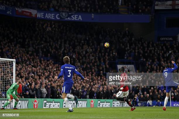 Chelsea's Spanish striker Alvaro Morata scores the opening goal during the English Premier League football match between Chelsea and Manchester...