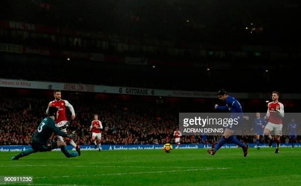 Chelsea's Spanish striker Alvaro Morata shoots by Arsenal's Czech goalkeeper Petr Cech during the English Premier League football match between...