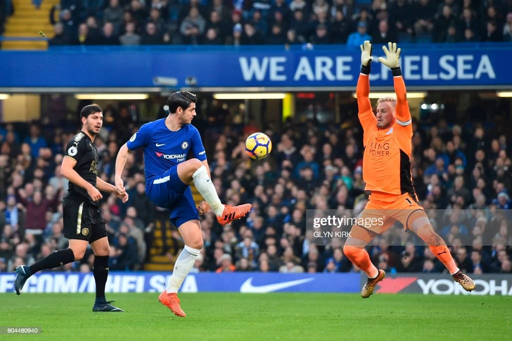 Chelsea's Spanish striker Alvaro Morata (C) shoots from an offside position as Leicester City's Danish goalkeeper Kasper Schmeichel (R) covers during the English Premier League football match between Chelsea and Leicester City at Stamford Bridge in London on January 13, 2018. / AFP PHOTO / Glyn KIRK / RESTRICTED TO EDITORIAL USE. No use with unauthorized audio, video, data, fixture lists, club/league logos or 'live' services. Online in-match use limited to 75 images, no video emulation. No use in betting, games or single club/league/player publications. /