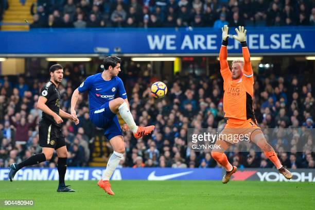 Chelsea's Spanish striker Alvaro Morata shoots from an offside position as Leicester City's Danish goalkeeper Kasper Schmeichel covers during the...