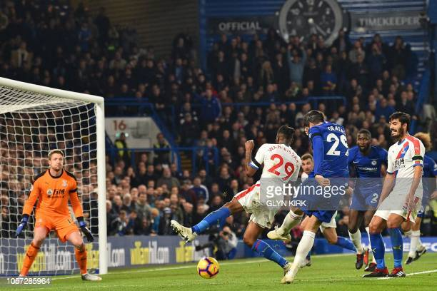 Chelsea's Spanish striker Alvaro Morata shoots the score their second goal during the English Premier League football match between Chelsea and...