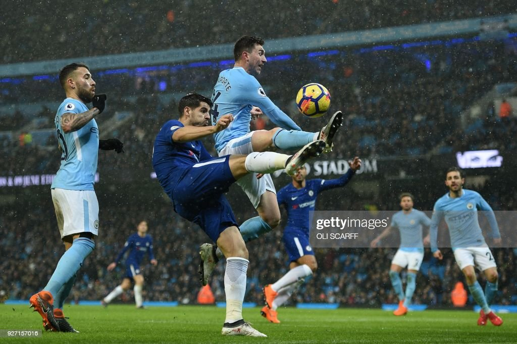Chelsea's Spanish striker Alvaro Morata (2L) takes a chance at goal during the English Premier League football match between Manchester City and Chelsea at the Etihad Stadium in Manchester, north west England on March 4, 2018. / AFP PHOTO / Oli SCARFF / RESTRICTED TO EDITORIAL USE. No use with unauthorized audio, video, data, fixture lists, club/league logos or 'live' services. Online in-match use limited to 75 images, no video emulation. No use in betting, games or single club/league/player publications. /