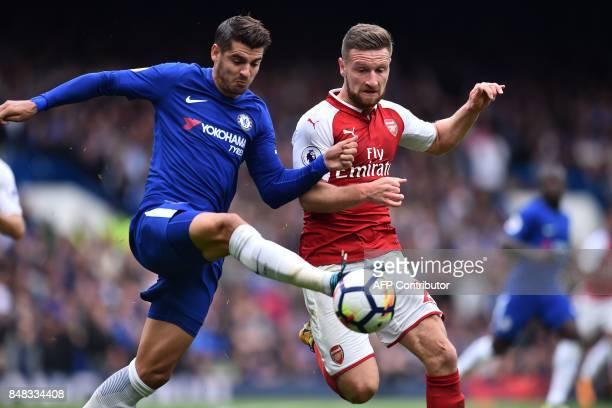 Chelsea's Spanish striker Alvaro Morata vies with Arsenal's German defender Shkodran Mustafi during the English Premier League football match between...