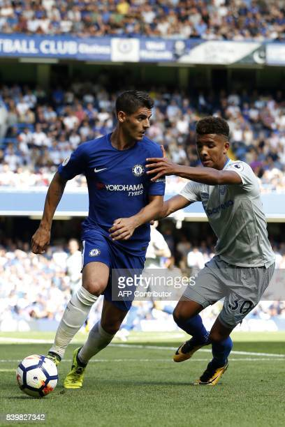 Chelsea's Spanish striker Alvaro Morata vies with Everton's English defender Mason Holgate during the English Premier League football match between...