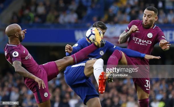 TOPSHOT Chelsea's Spanish striker Alvaro Morata vies with Manchester City's English midfielder Fabian Delph and Manchester City's Argentinian...