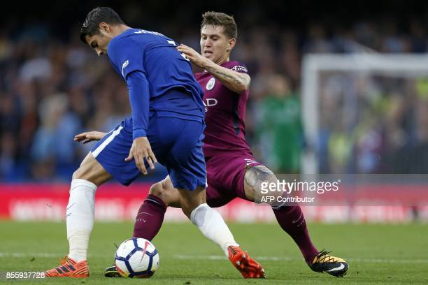 Chelsea's Spanish striker Alvaro Morata vies with Manchester City's English defender John Stones during the English Premier League football match...