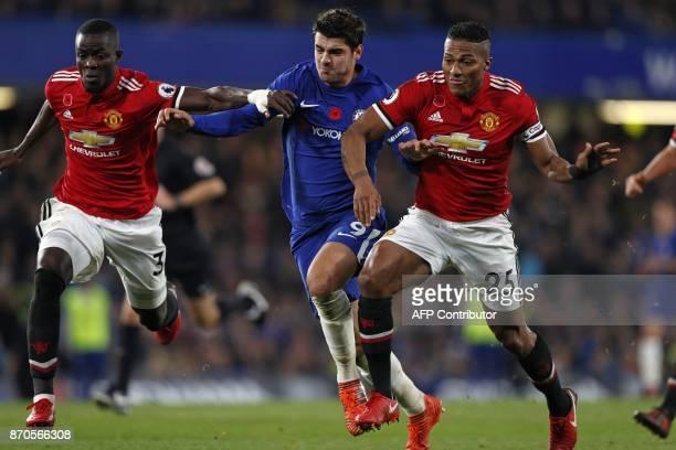 Chelsea's Spanish striker Alvaro Morata vies with Manchester United's Ivorian defender Eric Bailly and Manchester United's Ecuadorian midfielder...