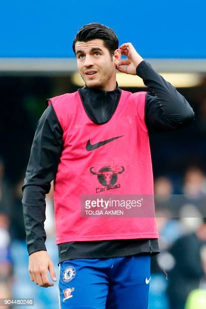 Chelsea's Spanish striker Alvaro Morata warms up before kick off of the English Premier League football match between Chelsea and Leicester City at...
