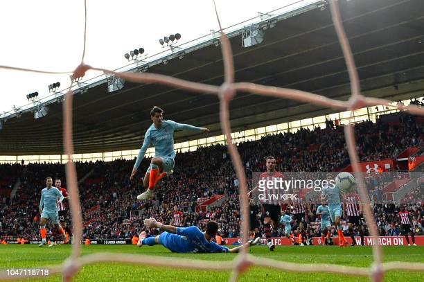 Chelsea's Spanish striker Alvaro Morata watches the ball as he hurdles Southampton's English goalkeeper Alex McCarthy to score his team's third goal...