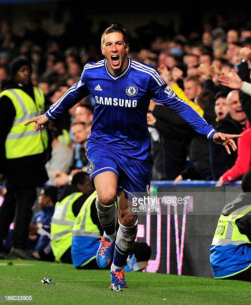 Chelsea's Spanish striker Fernando Torres celebrates scoring his team's second and winning goal during the English Premier League football match...