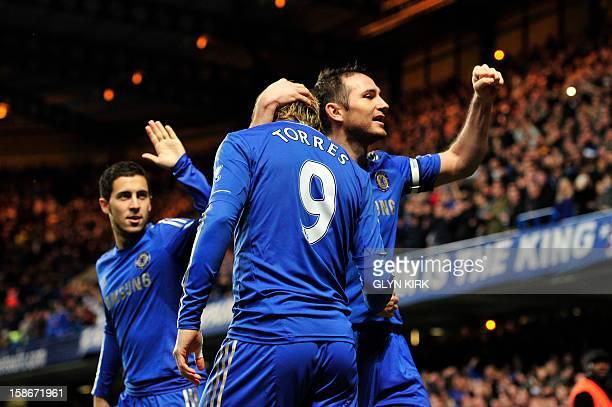 Chelsea's Spanish striker Fernando Torres celebrates scoring the opening goal with English midfielder Frank Lampard and Belgian midfielder Eden...