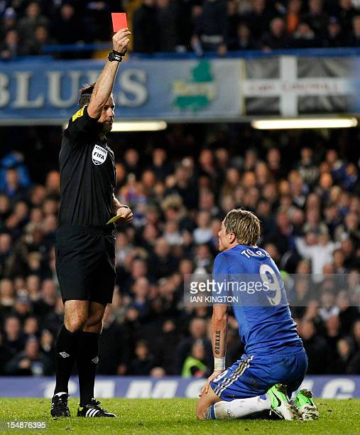 Chelsea's Spanish striker Fernando Torres is shown the red card by referee Mark Clattenburg during the English Premier League football match between...
