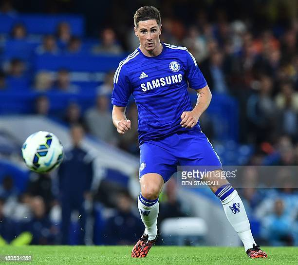 Chelsea's Spanish striker Fernando Torres passes the ball during the preseason football friendly match between Chelsea and Real Sociedad at Stamford...
