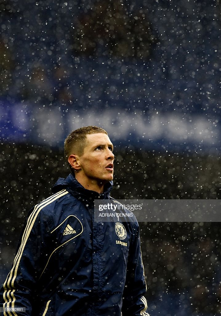 "Chelsea's Spanish striker Fernando Torres sporting a new haircut warms up ahead of the English Premier League football match between Chelsea and Arsenal at Stamford Bridge in London on January 20, 2013. USE. No use with unauthorized audio, video, data, fixture lists, club/league logos or ""live"" services. Online in-match use limited to 45 images, no video emulation. No use in betting, games or single club/league/player publications."