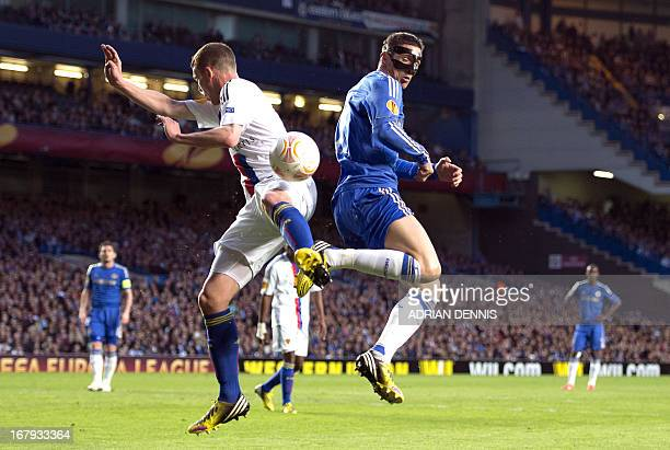 Chelsea's Spanish striker Fernando Torres vies for the ball against FC Basel's Swiss midfielder Fabian Frei during the Europa League semifinal second...