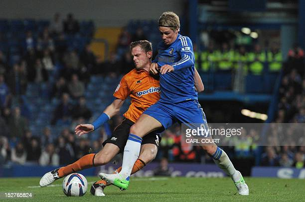 Chelsea's Spanish striker Fernando Torres vies with Wolverhampton Wanderers' English defender Richard Stearman during the third round English League...