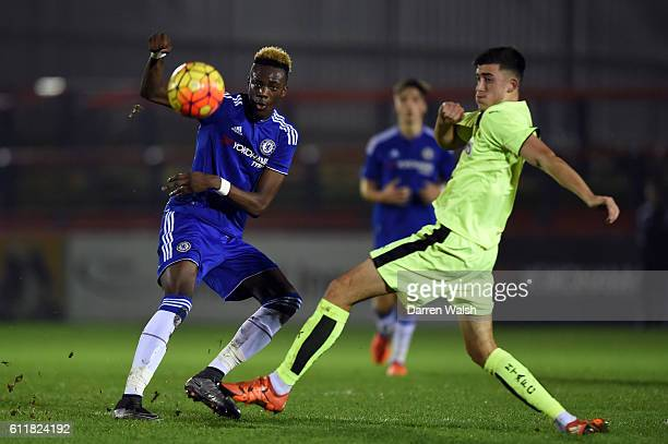 Chelsea's Tammy Abraham and Huddersfield Town's Dylan Cogill during a 3rd Rd FA Youth Cup match between Chelsea U18 and Huddersfield Town U18 at The...
