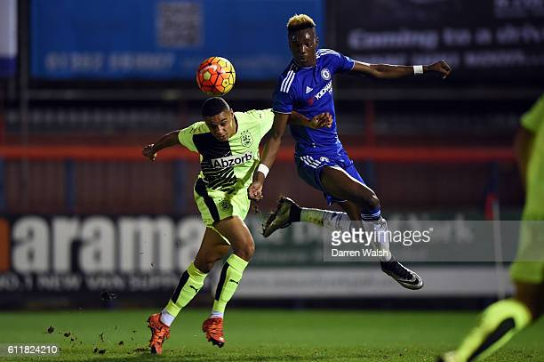 Chelsea's Tammy Abraham and Huddersfield Town's Jacob Hanson during a 3rd Rd FA Youth Cup match between Chelsea U18 and Huddersfield Town U18 at The...