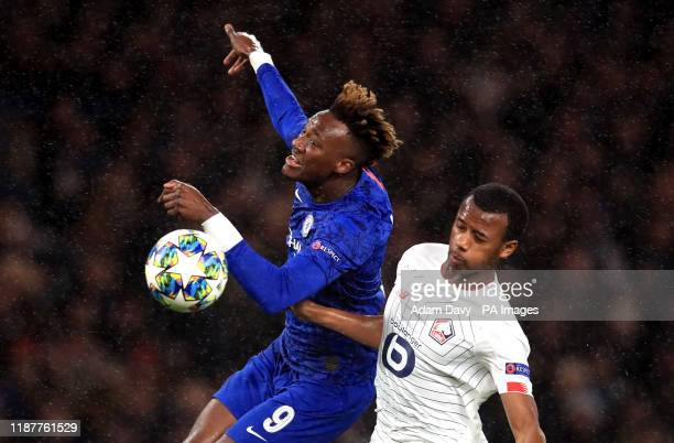 Chelsea's Tammy Abraham and Lille's Magalhaes Gabriel battle for the ball during the UEFA Champions League match at Stamford Bridge London