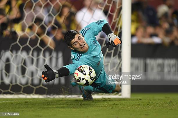 Chelsea's Thibaut Courtois saves a penalty during the penalty shootout during a Pre Season Friendly match between Barcelona and Chelsea at FedEx...