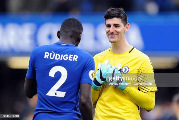 Chelsea's Thibaut Courtois with Antonio Rudiger after the Premier League match between Chelsea and Newcastle United at Stamford Bridge on December 2...