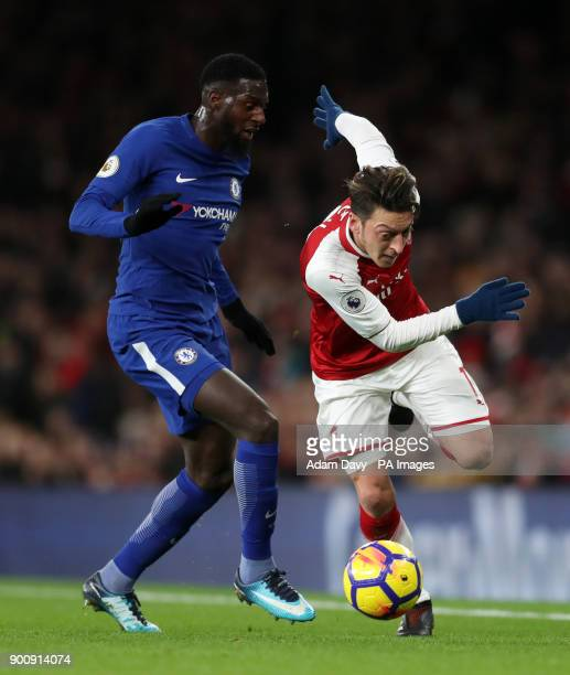 Chelsea's Tiemoue Bakayoko and Arsenal's Mesut Ozil battle for the ball during the Premier League match at the Emirates Stadium London