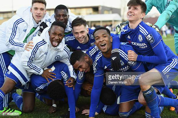 Chelsea's U19 Tammy Abraham celebrates his penalty and winning goal with the rest of the team during a round of 16 Youth League match between Chelsea...