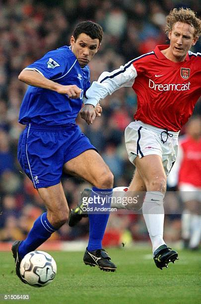Chelsea's Uruguayan player Gustavo Poyet is chased by Arsenal's Ray Parlour during a premier league match at Highbury stadium in London 13 January...
