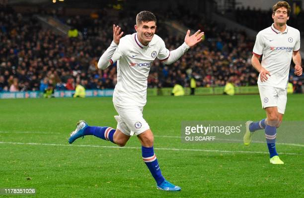 Chelsea's US midfielder Christian Pulisic celebrates scoring their third goal to complete his hattrick during the English Premier League football...