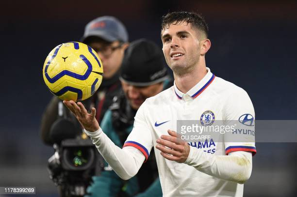 Chelsea's US midfielder Christian Pulisic leaves the pitch holding the match ball after scoring a hattrick to help his team to a 2-4 victory during...