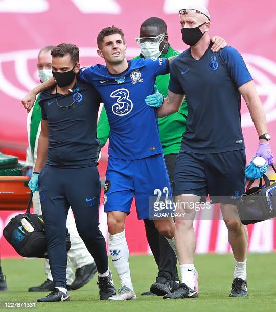 Chelsea's US midfielder Christian Pulisic leaves the pitch injured during the English FA Cup final football match between Arsenal and Chelsea at...