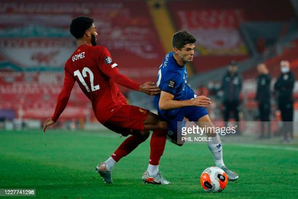 Chelsea's US midfielder Christian Pulisic rounds Liverpool's English defender Joe Gomez during the English Premier League football match between...