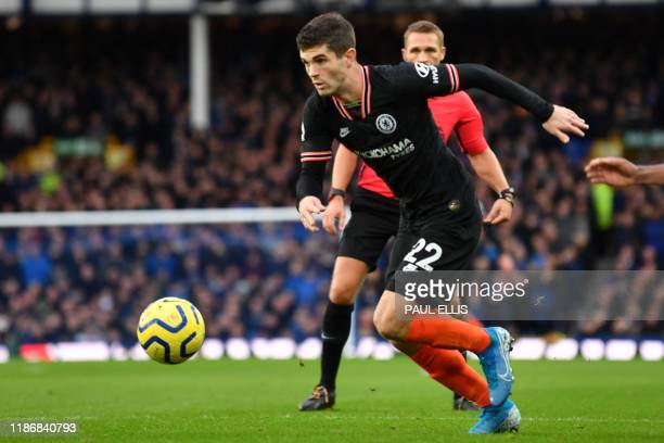 Chelsea's US midfielder Christian Pulisic runs with the ball during the English Premier League football match between Everton and Chelsea at Goodison...