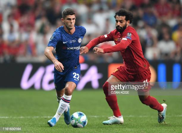 Chelsea's US midfielder Christian Pulisic vies for the ball with Liverpool's Egyptian midfielder Mohamed Salah during the UEFA Super Cup 2019...