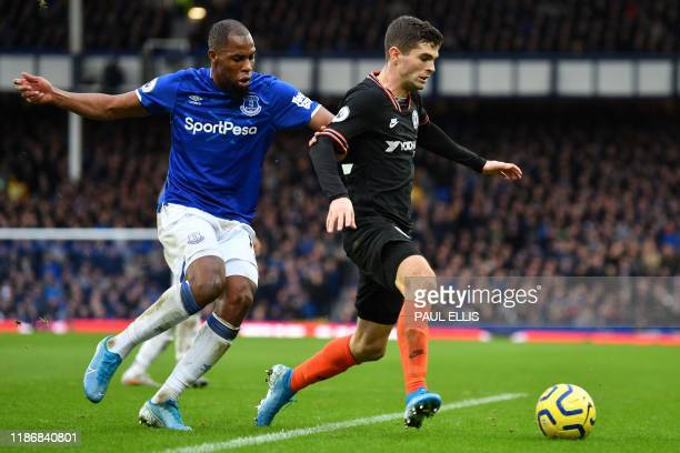 Chelsea's US midfielder Christian Pulisic vies with Everton's French Defender Djibril Sidibe during the English Premier League football match between...