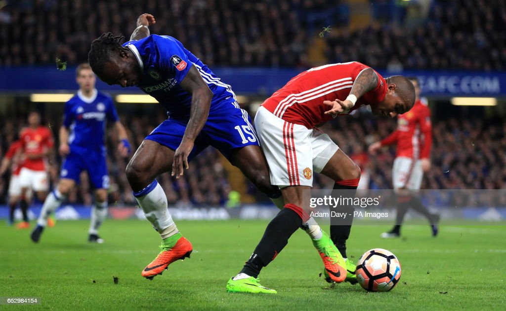 Chelsea's Victor Moses and Manchester United's Ashley Young (right) during the Emirates FA Cup, Quarter Final match at Stamford Bridge, London.